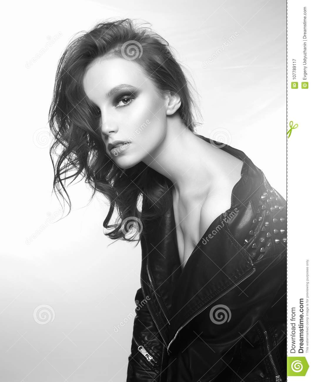 Beautiful young woman in leather coat fashion black and white portrait