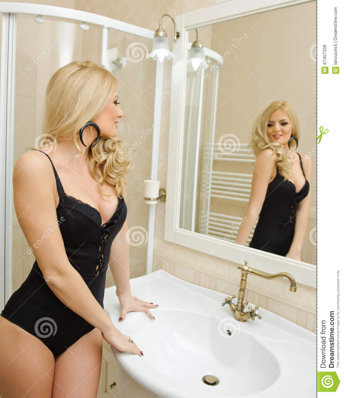 Beautiful young woman wearing black lingerie in bathroom sensual blonde in front of the mirror - Lingerie salle de bain ...
