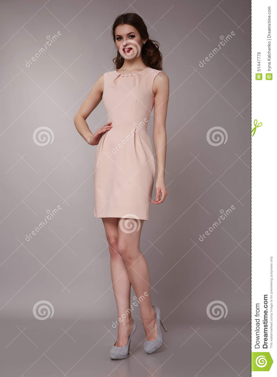 b5ac4b339dc235 Beautiful young girl with long wavy blond hair with a bright evening  make-up perfect summer tan thin figure dressed in colored short dress and high  heels ...