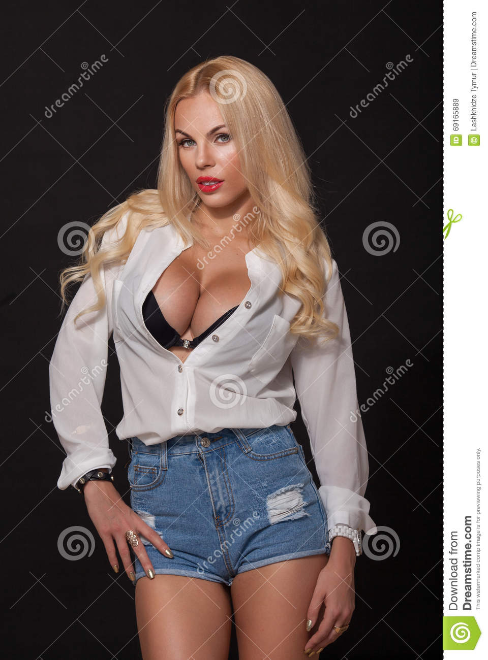 blond girl. big boobs. on black background stock image - image of