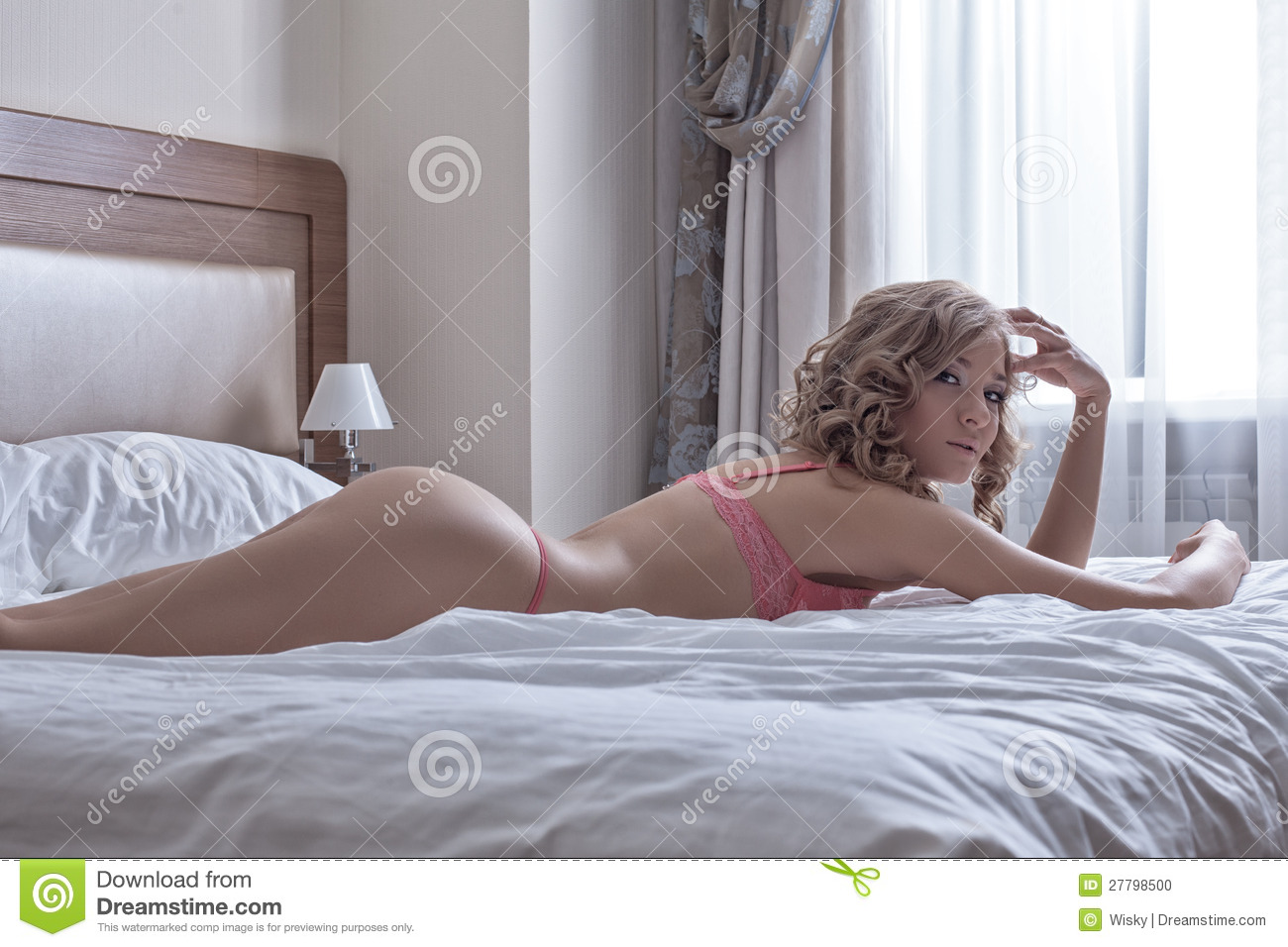 sexy blond girl lay in huge bed at morning stock photo image 27798500. Black Bedroom Furniture Sets. Home Design Ideas