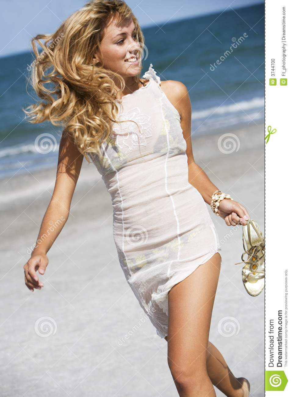 blond walking on beach