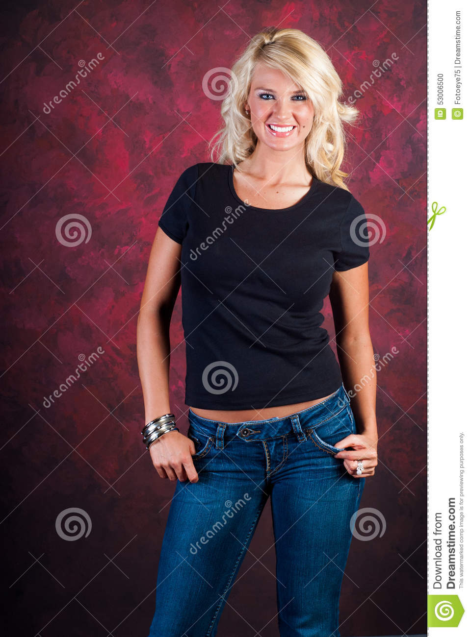 Blonde girl fashion model in blue jeans stock photo Black shirt blue jeans
