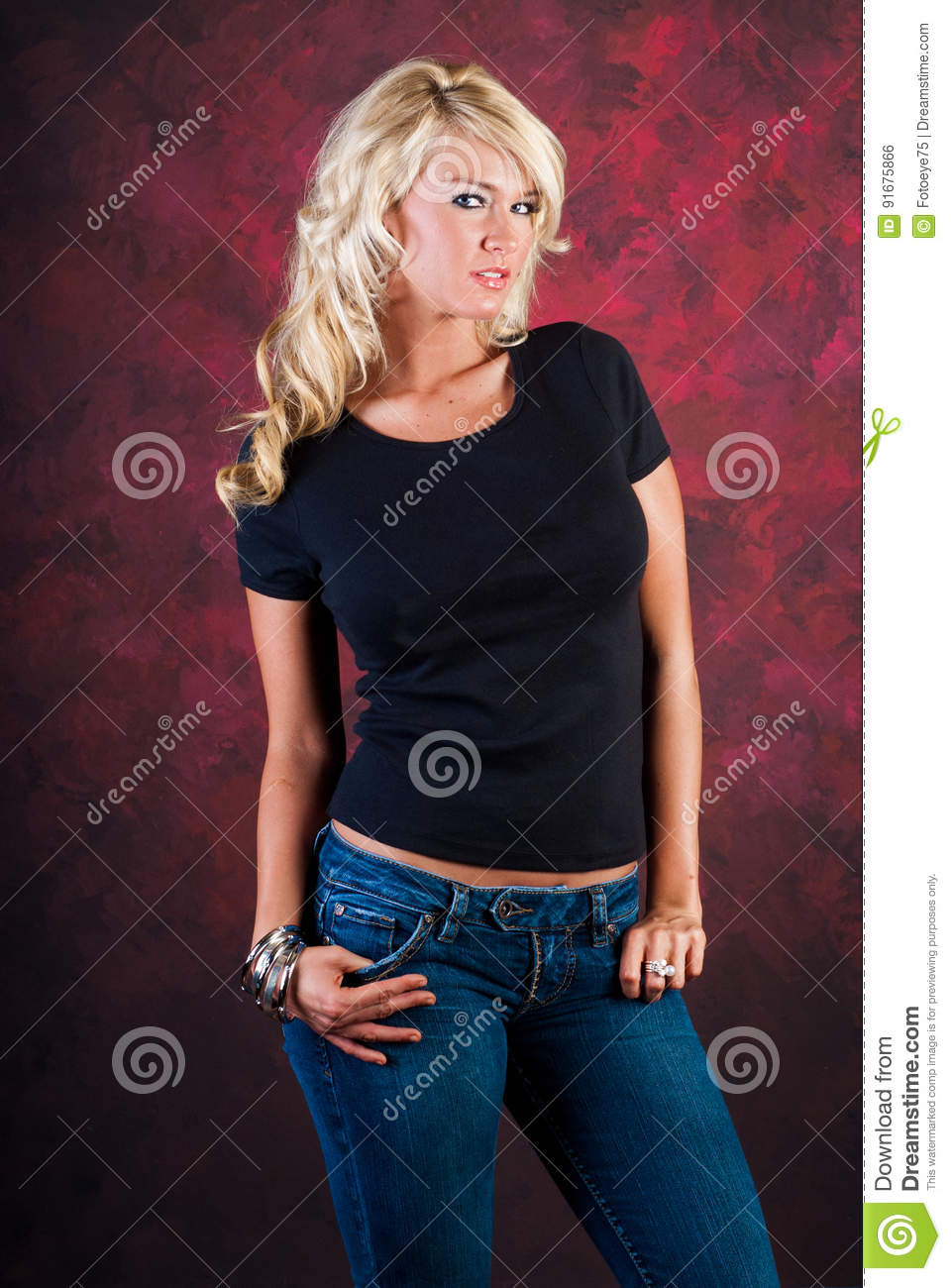 blonde girl fashion model in blue jeans