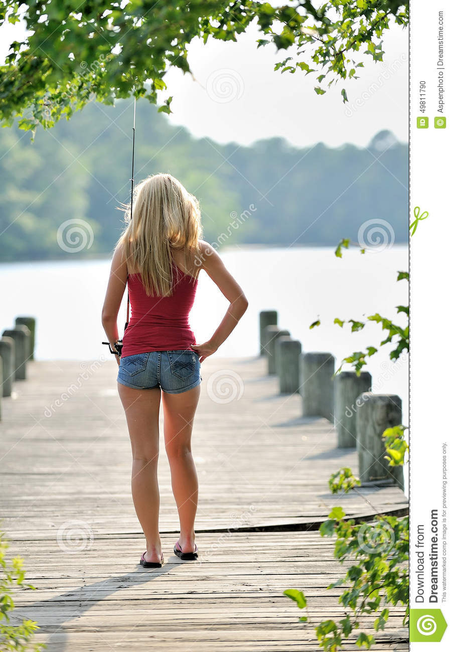 Blonde woman fishes from dock stock photo image 49811790 for Best fishing shorts