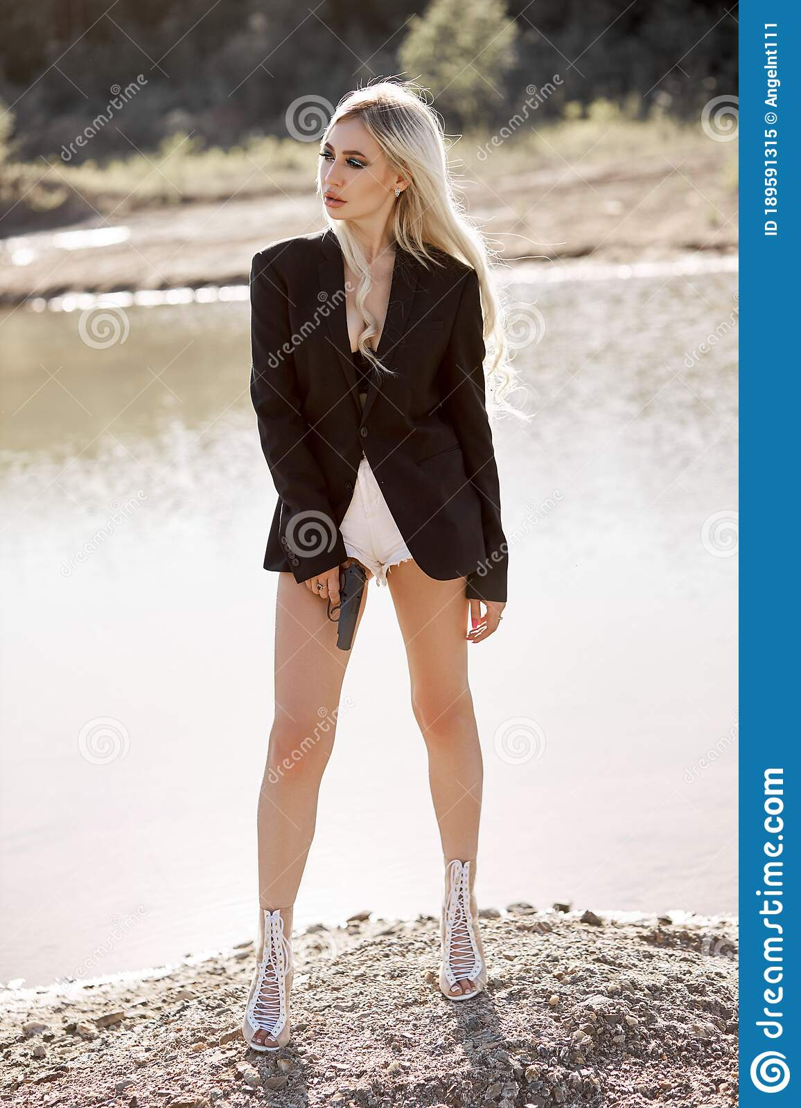 Blonde Woman With A Gun In Her Hands Spy Girl In Short Shorts And Weapons In Hand Stock Image Image Of Hand Military 189591315