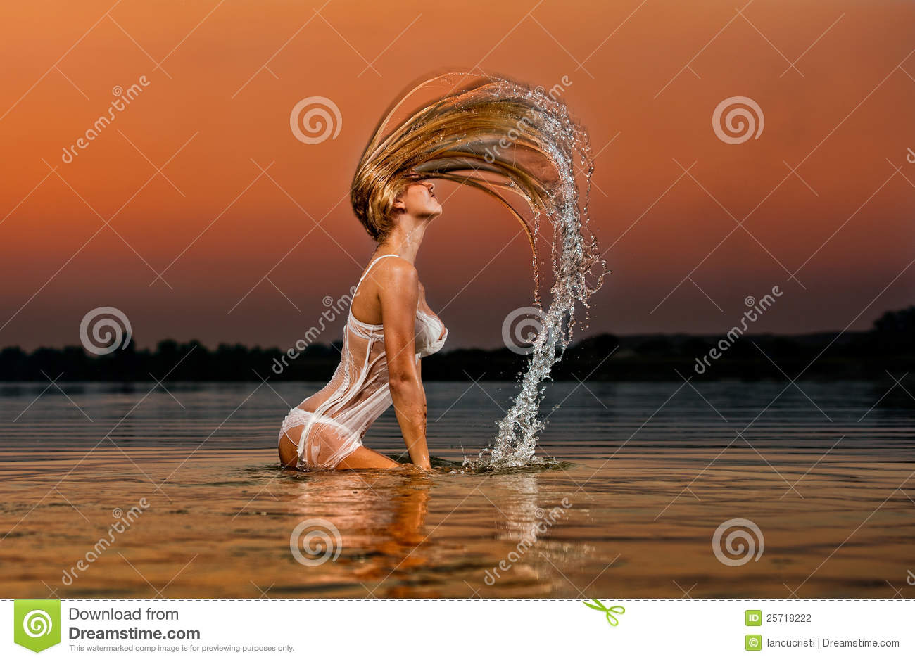 blonde woman in water at sunset