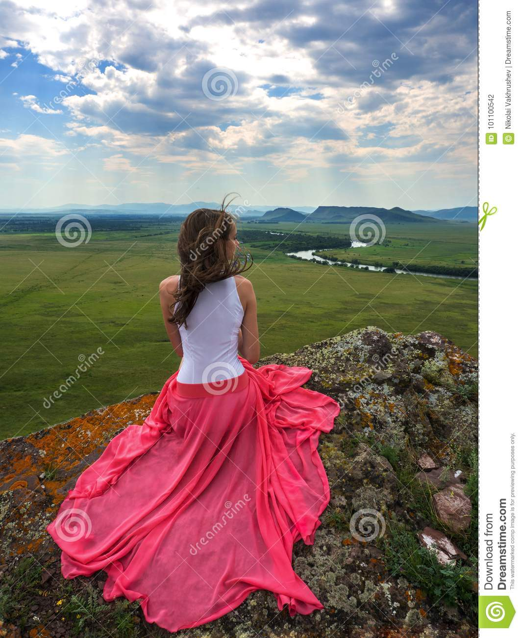Download Brunette In A Beautiful Dress On The Edge Of A Cliff. Stock Photo - Image of hair, long: 101100542