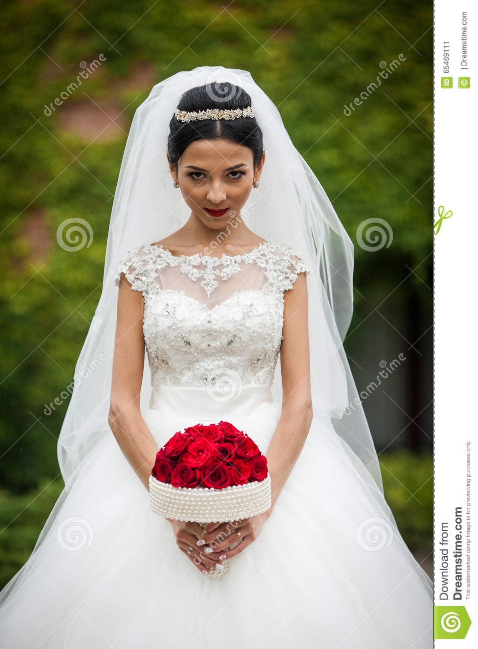 Brunette Bride In Vintage Stylish White Dress With Red Rose Stock
