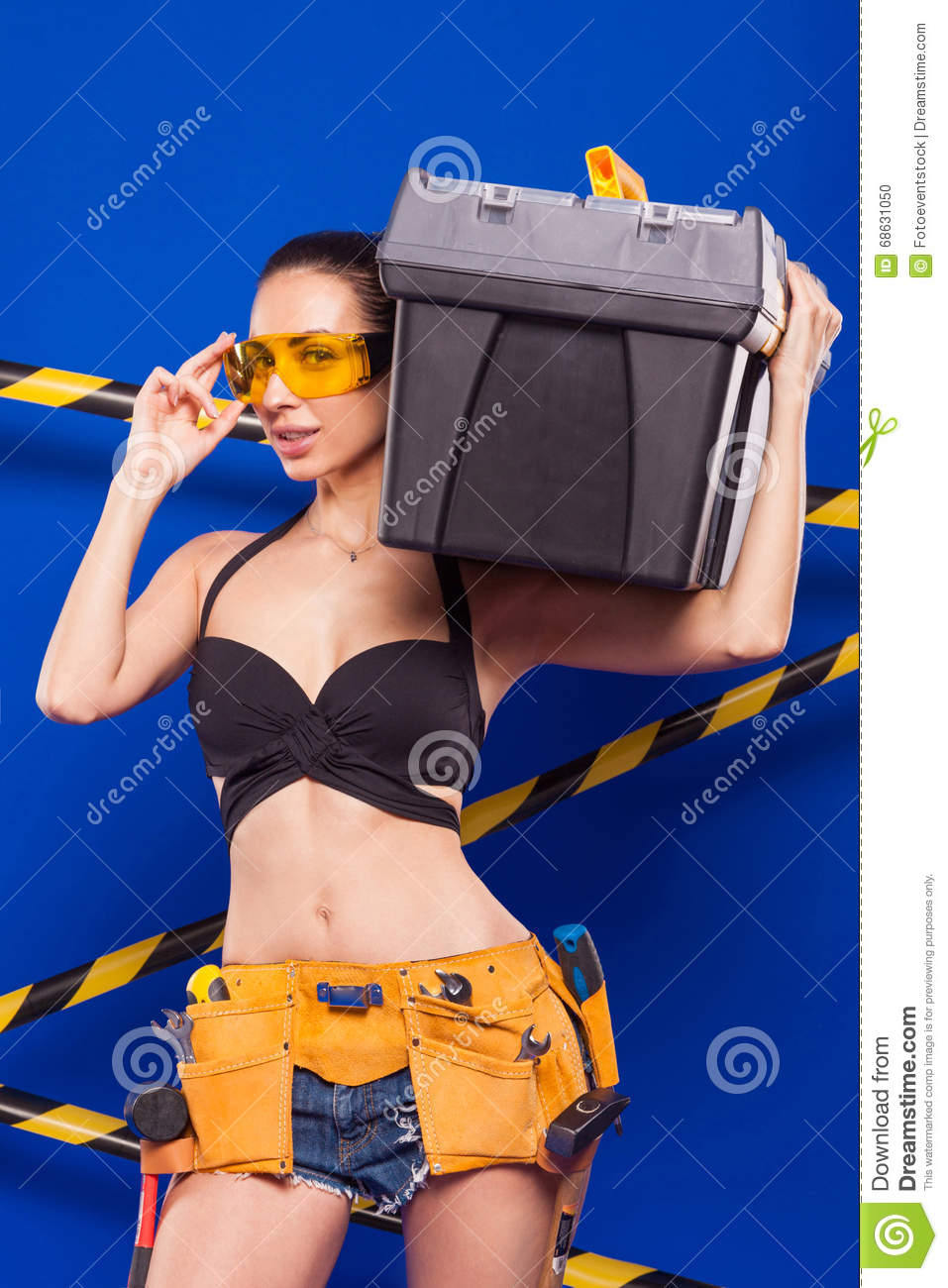 Sexy Brunette Builder On A Blue Background With An -4458
