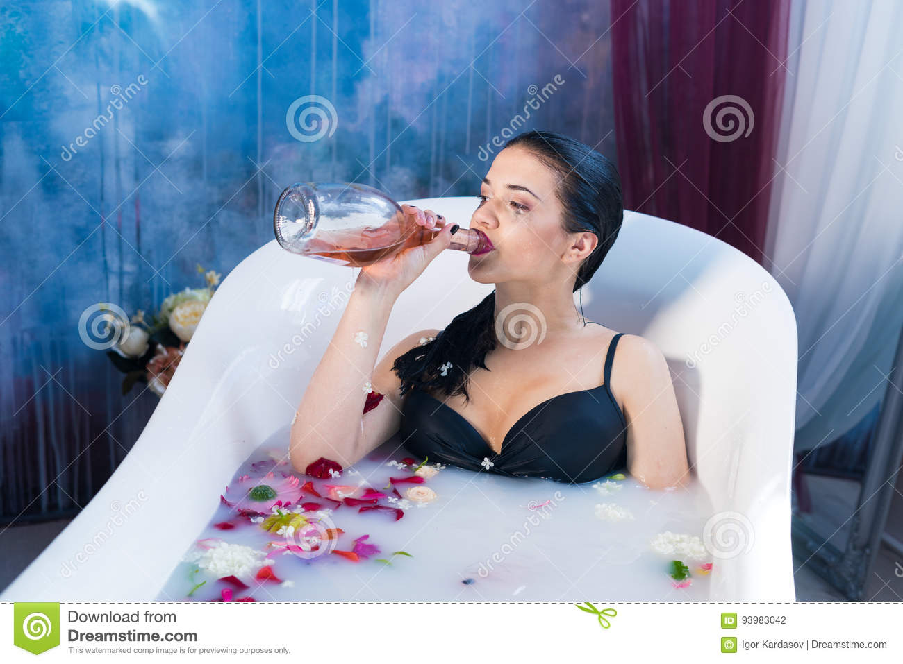 brunette drunk woman relaxing in a hot bath stock photo - image of