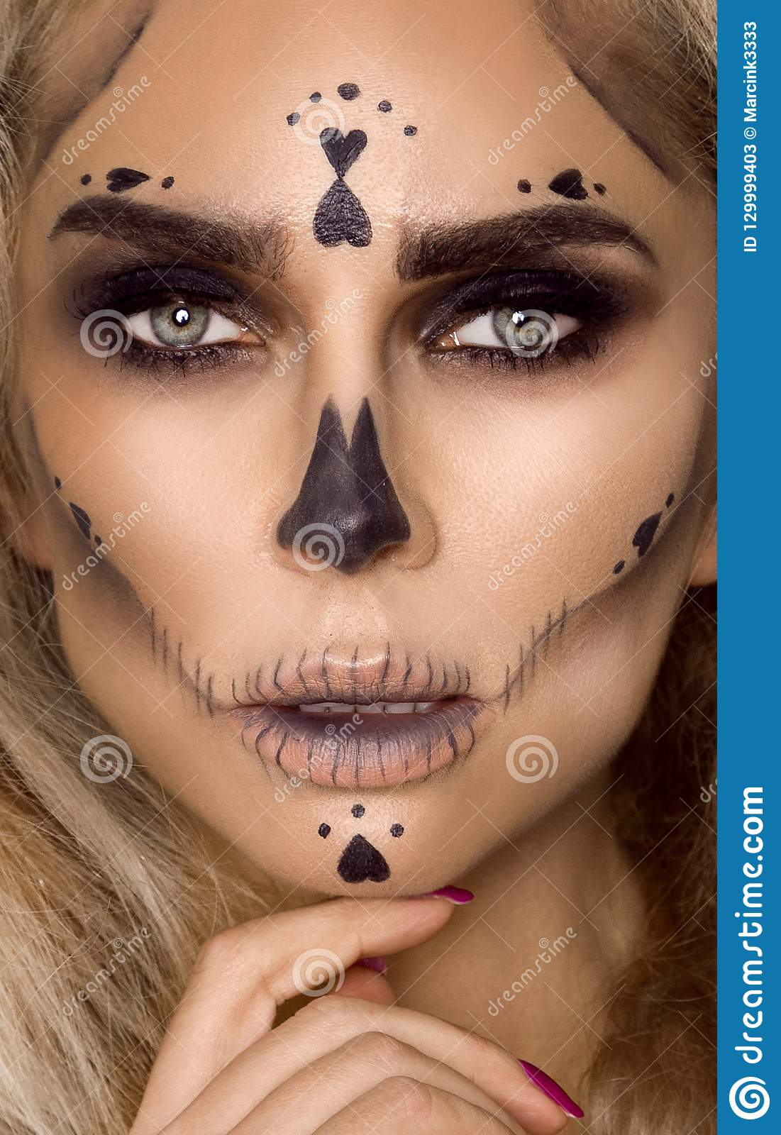 Halloween Make Up Skelet.Brunette Woman In Halloween Makeup And Lingerie Hold A