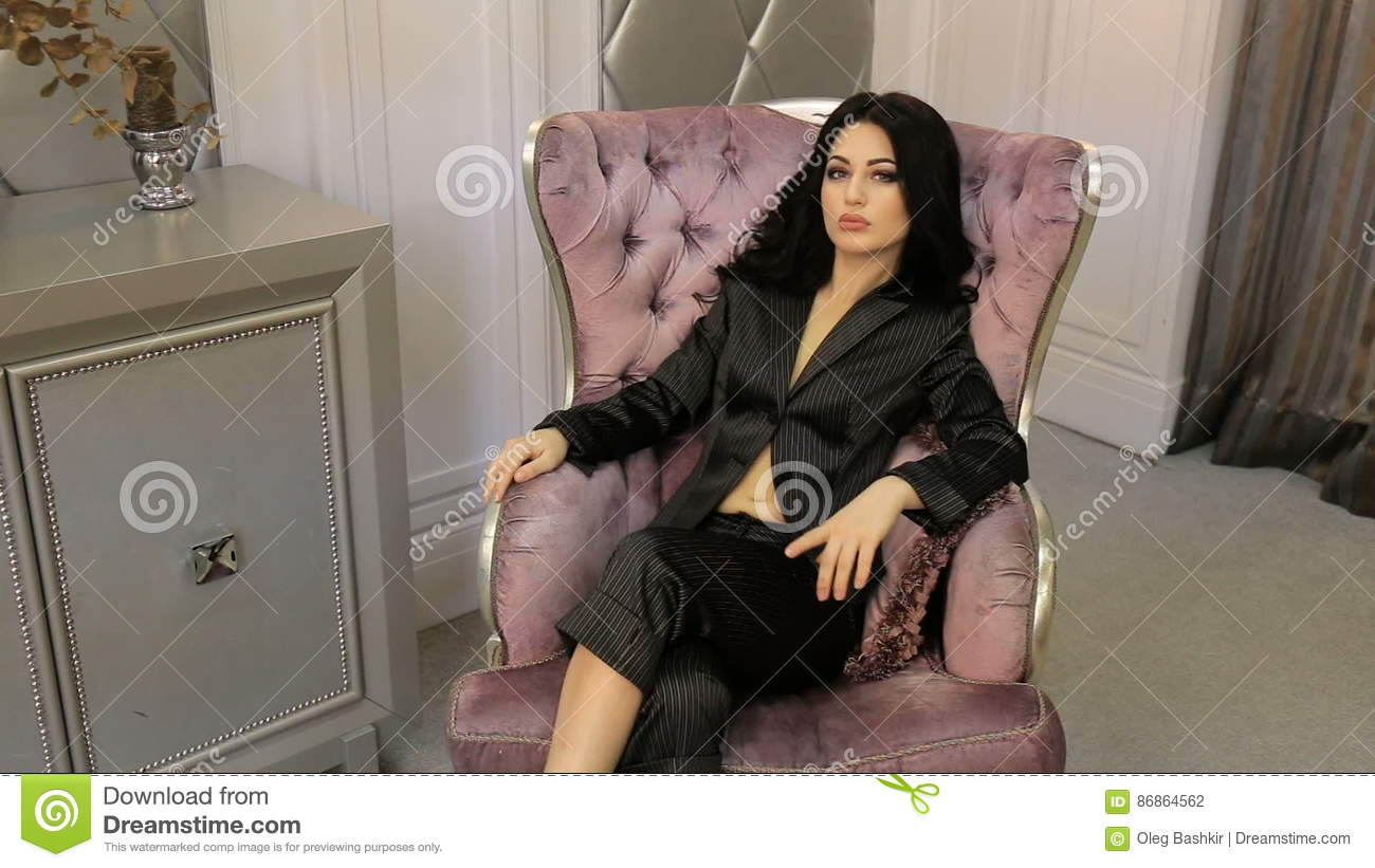 Brunette Posing While Sitting In A Chair. Full Hd Video Stock ...