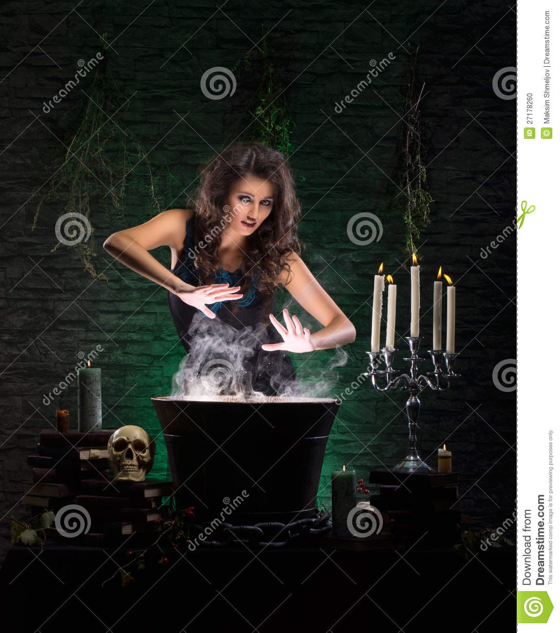 A brunette witch making poison