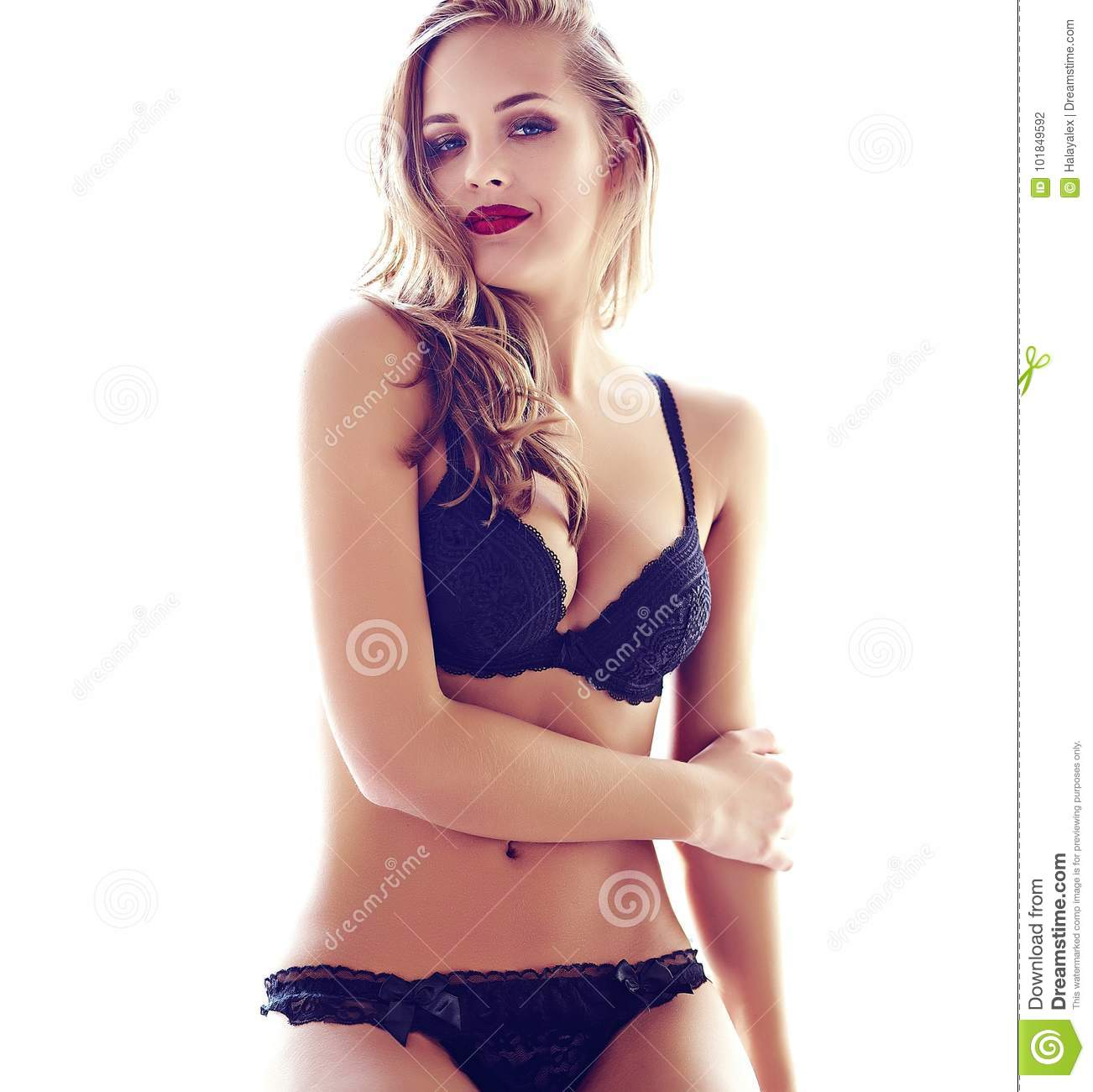566702fcc Fashion portrait of beautiful young adult blond woman model wearing black  erotic lingerie posing in light interior in the morning