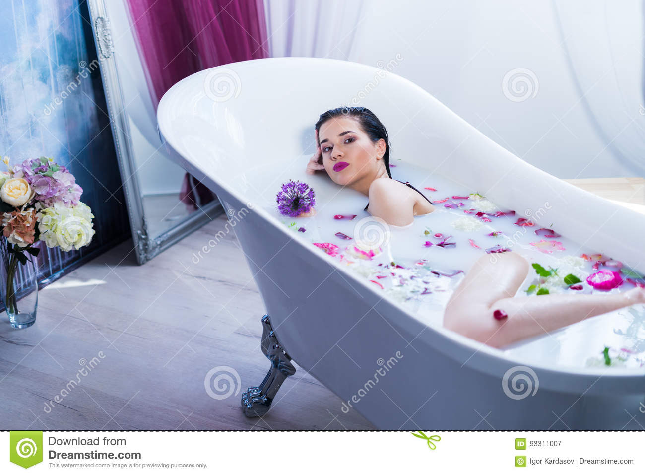 Brunette Woman Relaxing In A Hot Bath With Flowers Stock Image ...