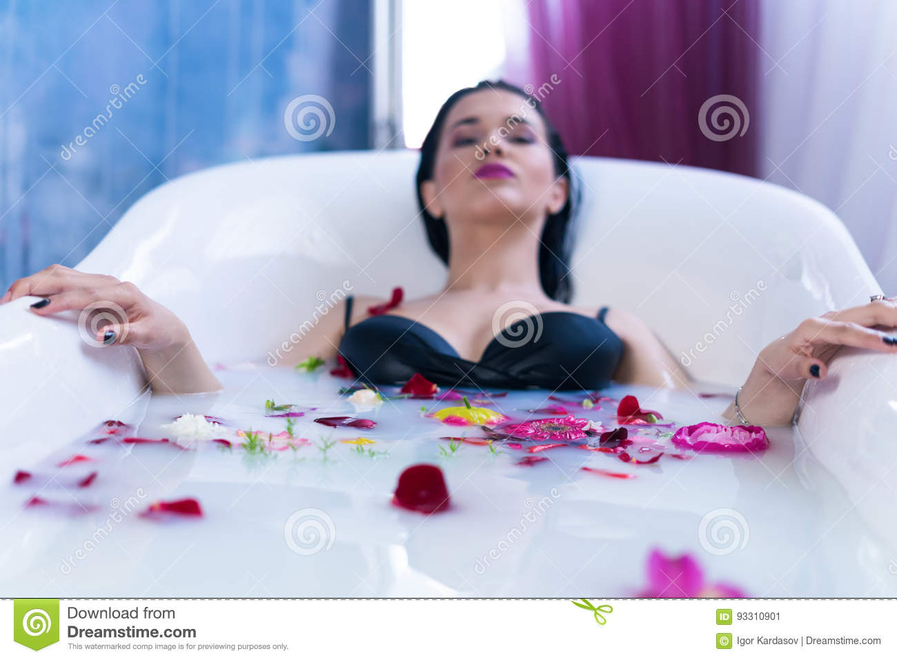 Brunette Woman Relaxing In Hot Milk Bath With Flowers Stock Image ...
