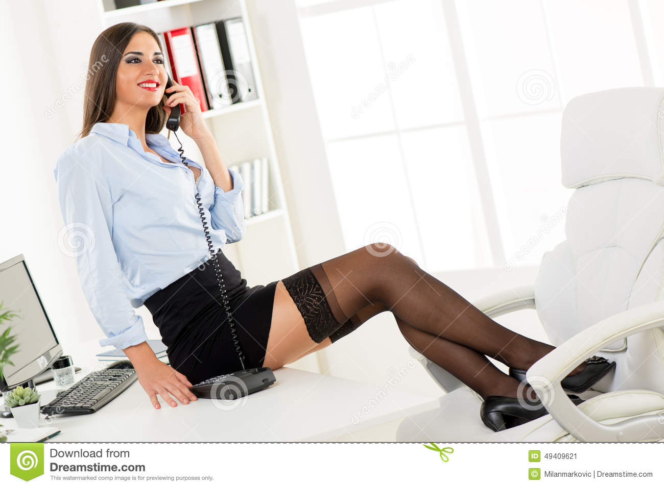 Sexy Businesswoman Phoning Stock Photo - Image: 49409621