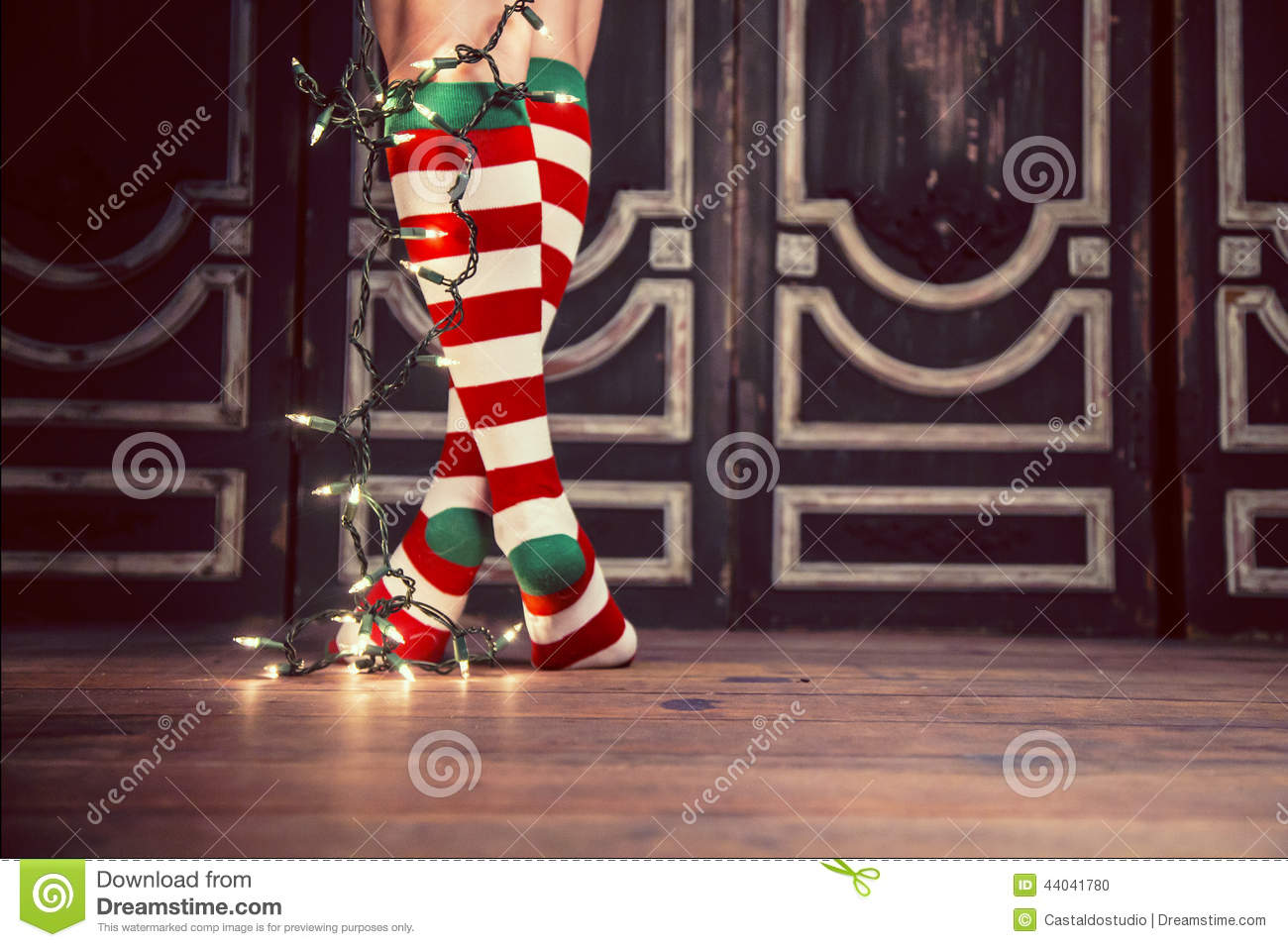 04d05318c93 A woman legs wearing christmas socks with christmas lights