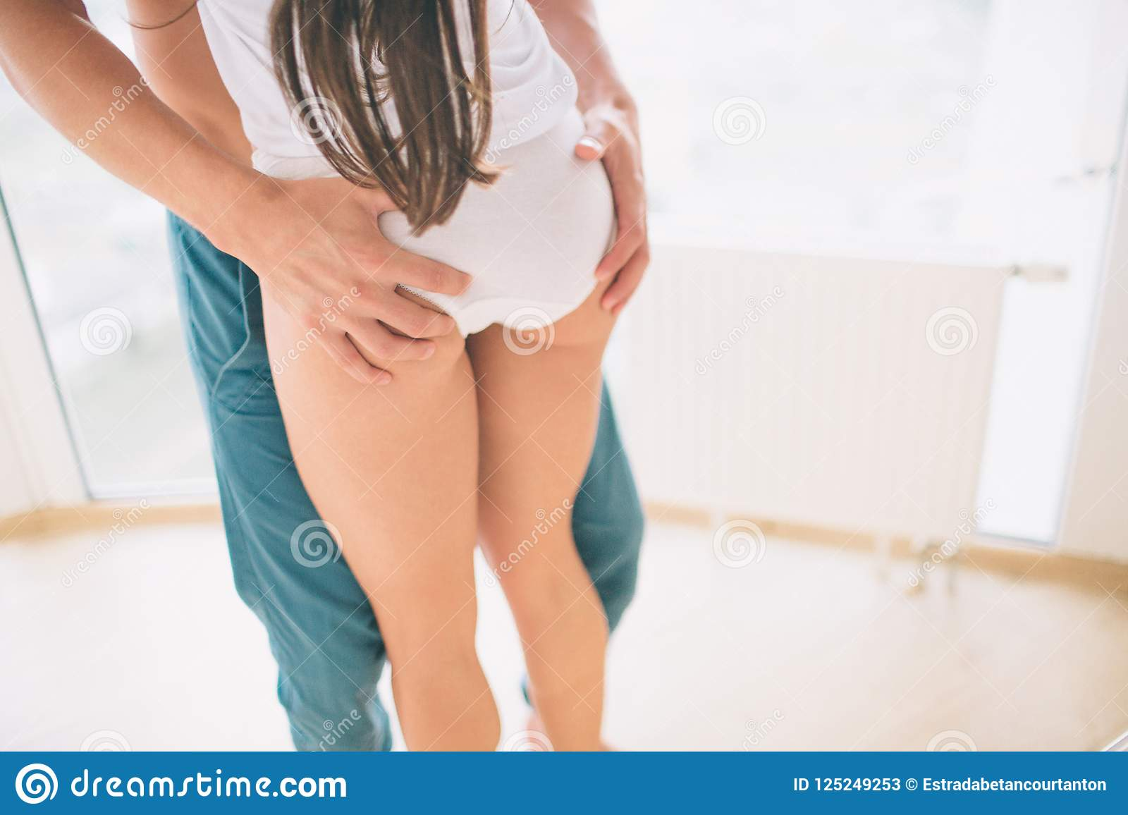Muscl guy around sexy girls holding them Close Up Of Guy Holding Hands On Girl S Buttocks They Stand Very Close To Each Other Stock Image Image Of Body Muscular 125249253