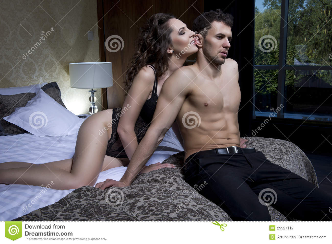 romantic couple kissing in bedroom