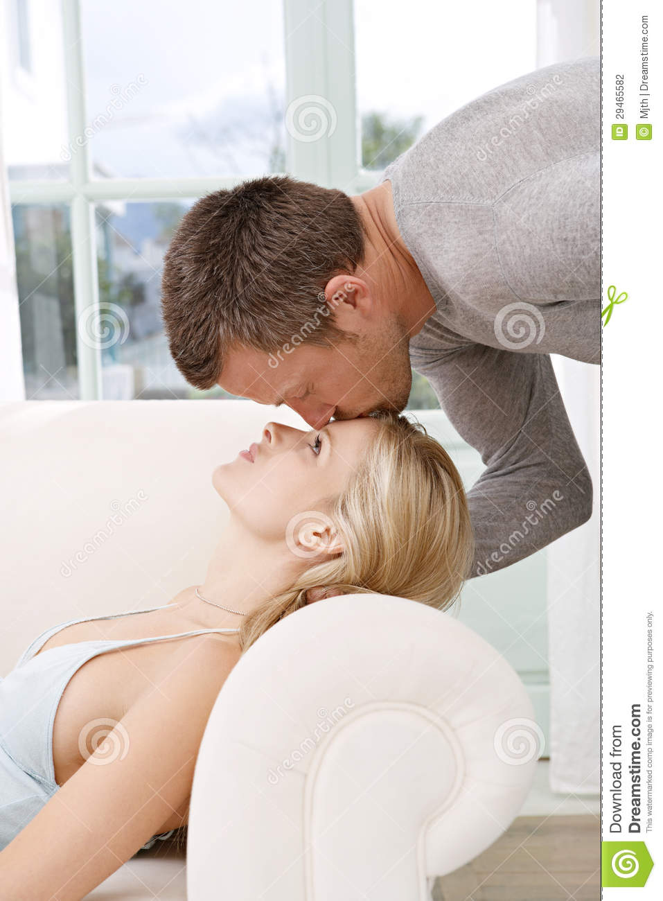 man kissing woman on couch. Black Bedroom Furniture Sets. Home Design Ideas