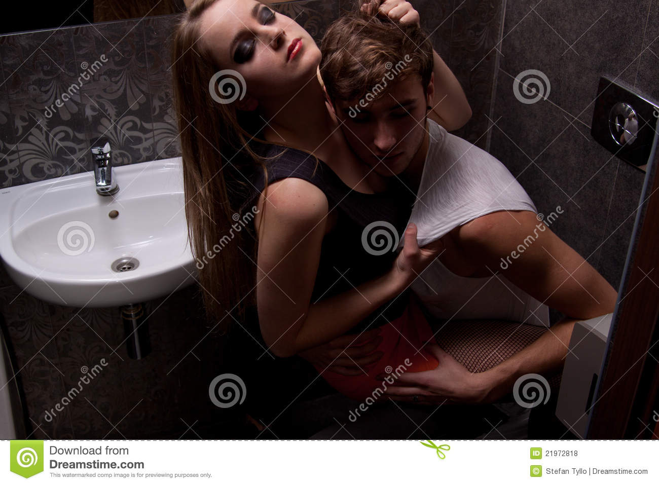 Couple In Toilet, Fooling Around Stock Photo - Image of