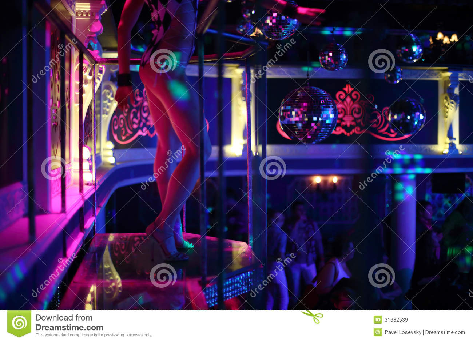Dancer Dances On A Podium In A Nightclub Editorial Stock