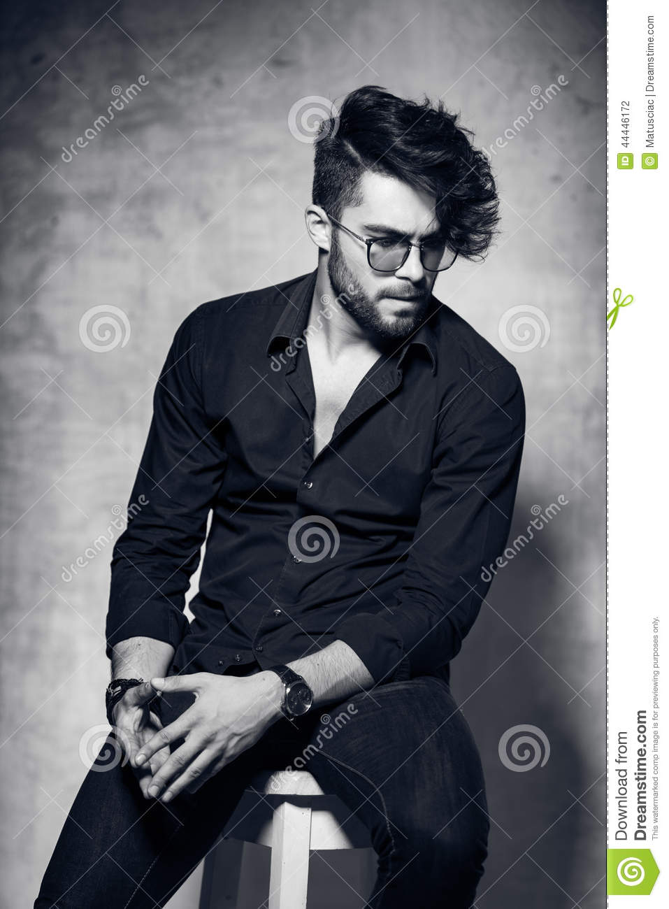 fashion man model dressed casual wearing glasses posing dramatic against grunge wall stock photo. Black Bedroom Furniture Sets. Home Design Ideas