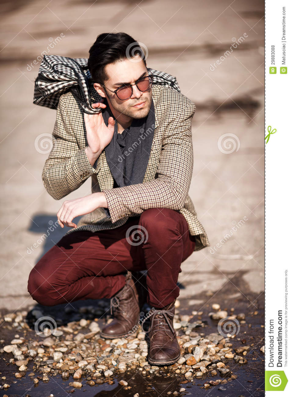 Sexy Fashion Man Model Dressed Elegant Holding A Bag