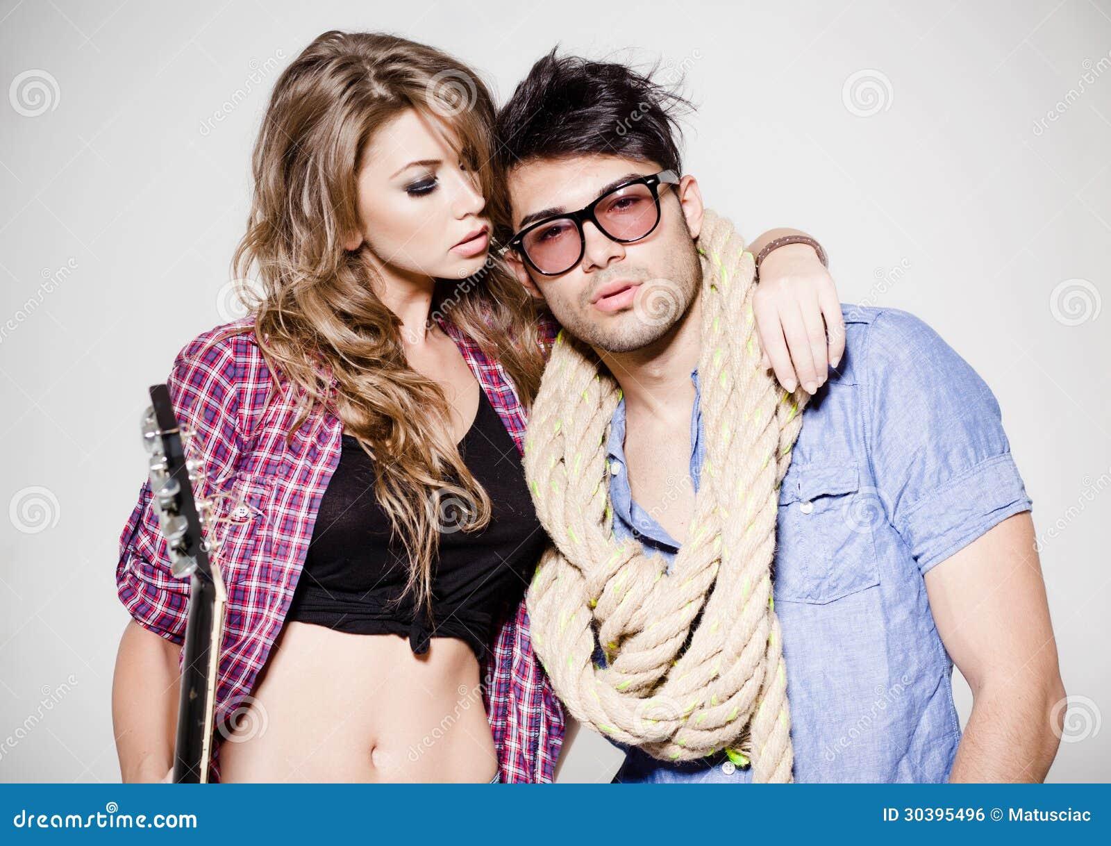 fashionable couple wearing jeans posing dramatic