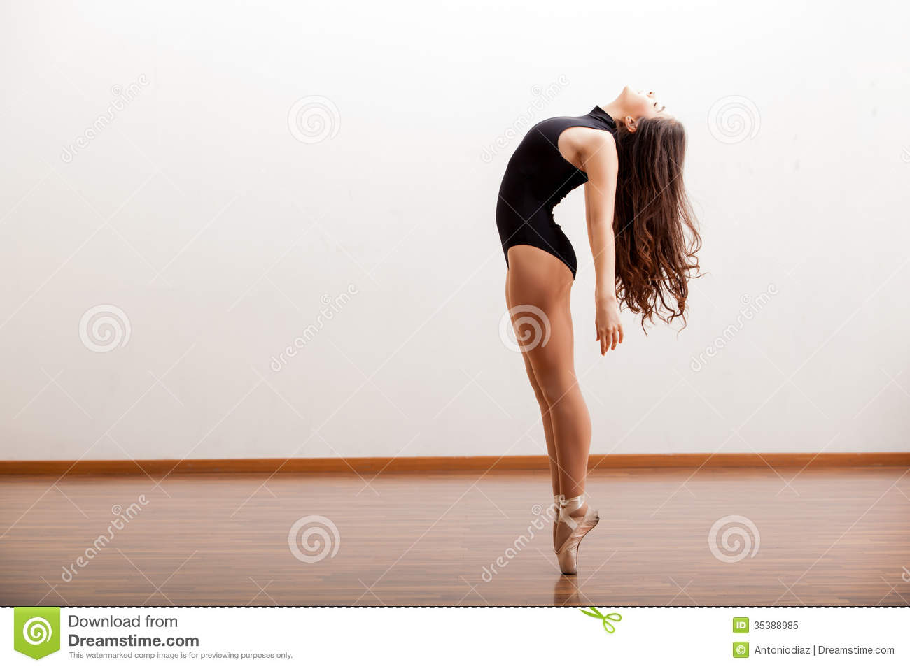 Gorgeous ballet dancer maintaining balance during a dance routine in a