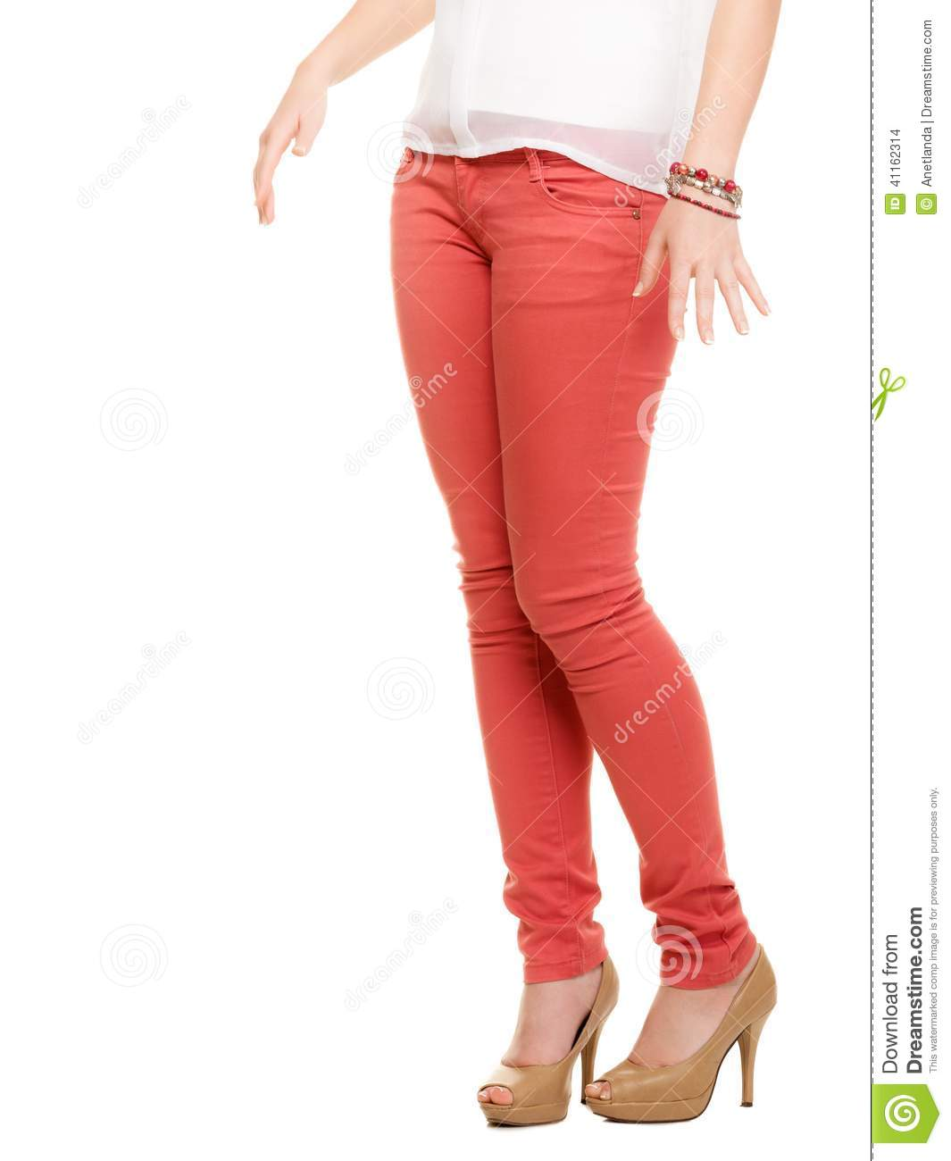 3a47a0a0a8b Closeup of female legs in red pants and beige high heels shoes boots  isolated on white.