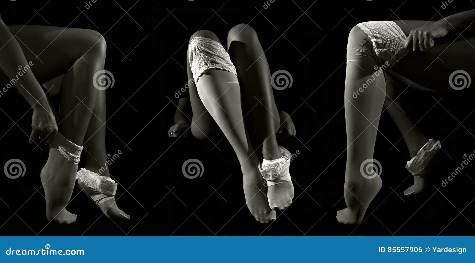 Sexy Frau setzte an ihre weißen Nylonstrümpfe auf lange Sitzbeine