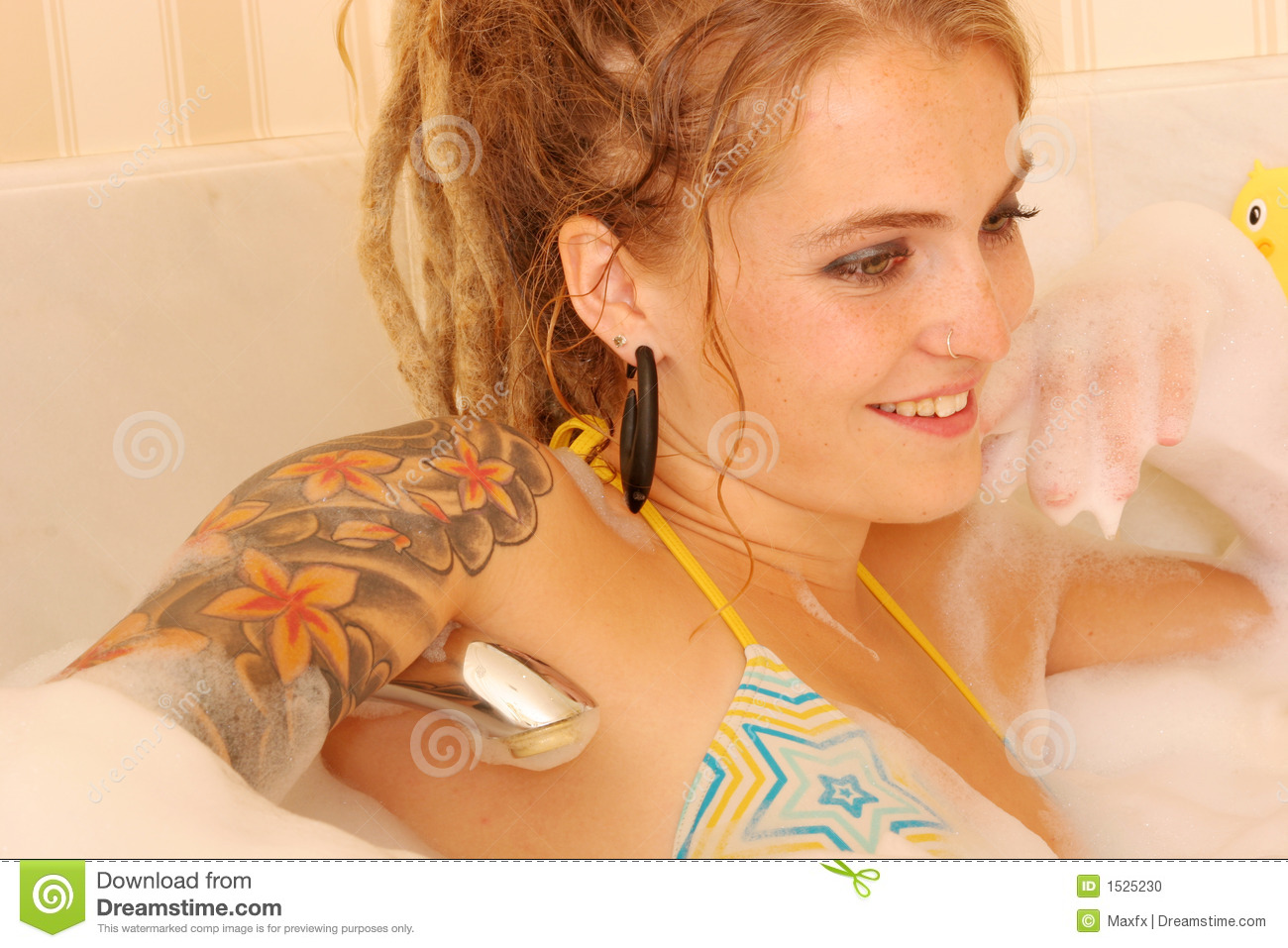 Baby in bubble bath. With rubber ducks stock images