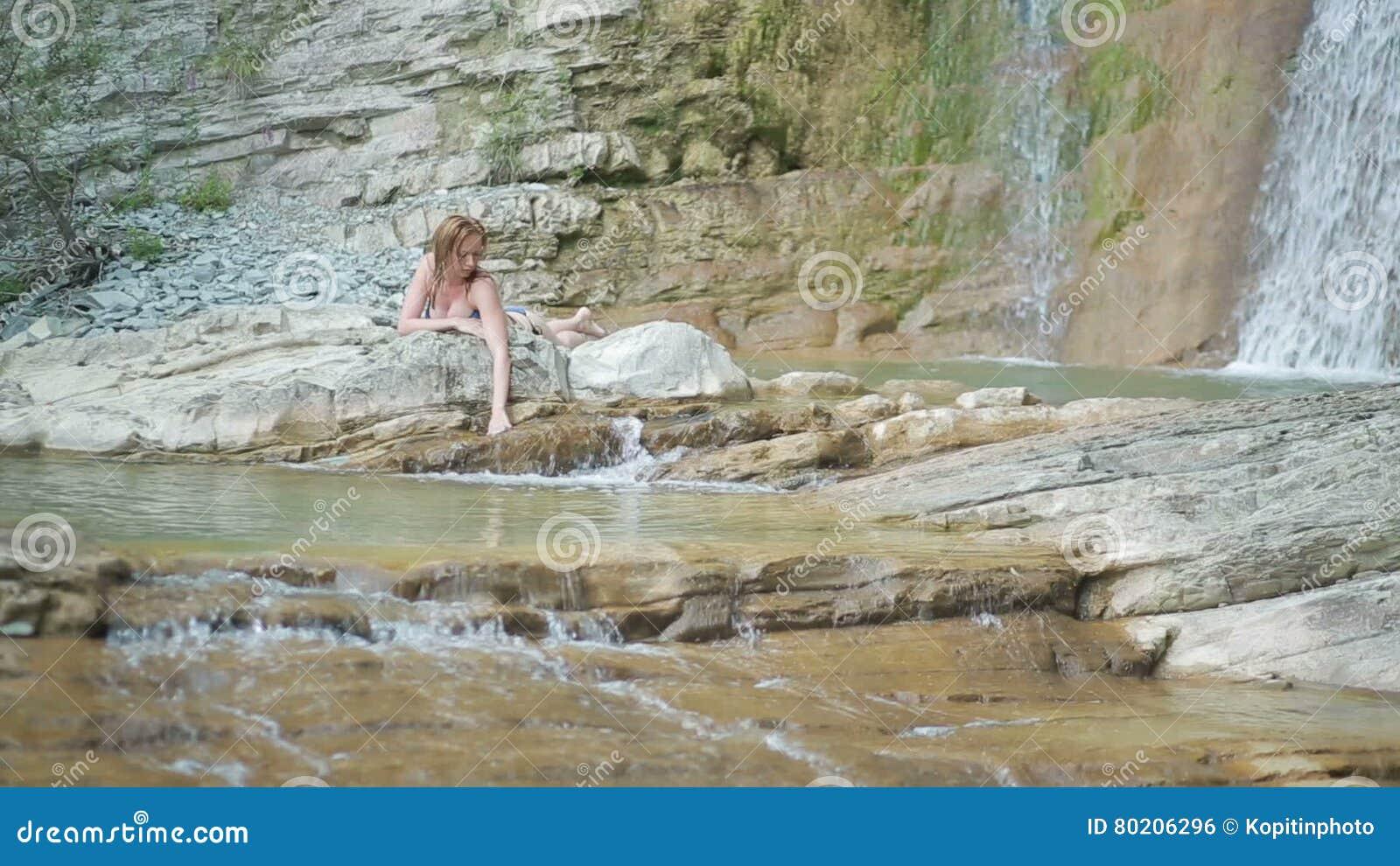 Girl With Bikini Taking A Shower In Waterfall Stock Footage