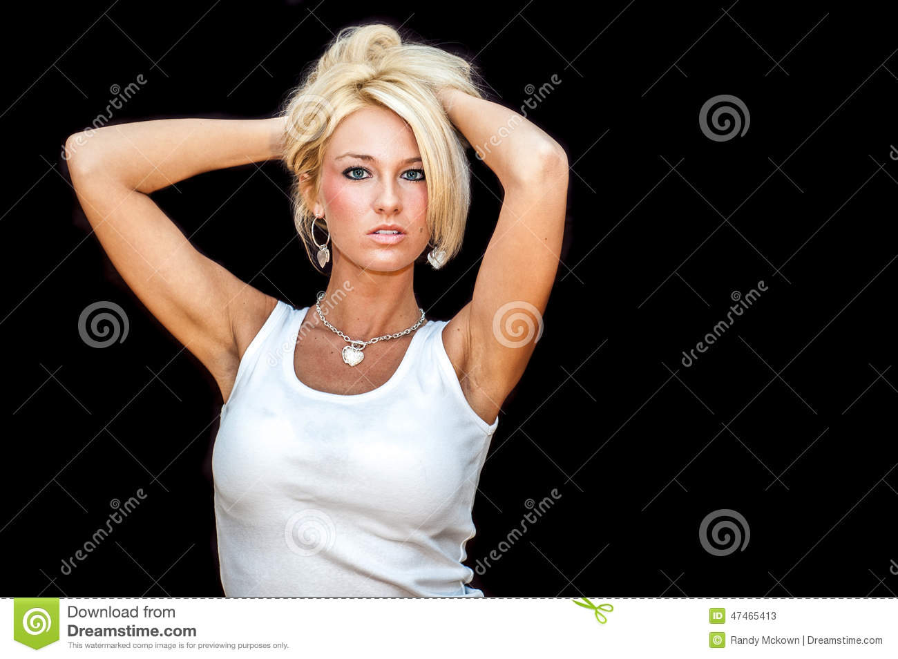 5d7a7fbf944 woman / girl blonde fashion model. Dressed in casual white tank top shirt.  Woman / female studio portrait isolated against black background.
