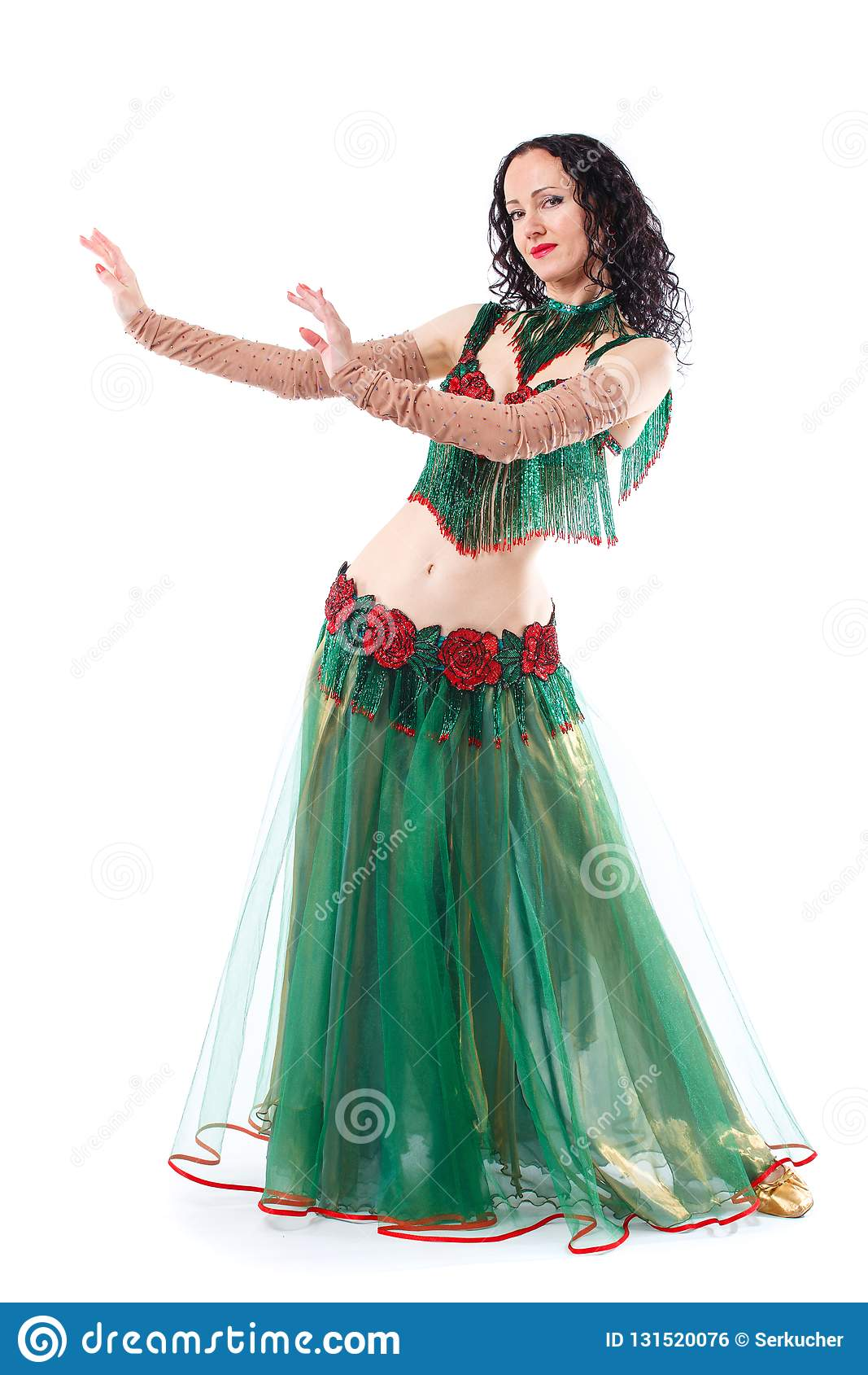15c8ef10a girl dancing belly dance. During the dance the young girl stopped. Isolated  on a white background