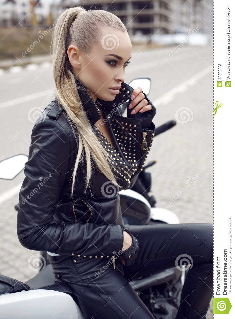 7eb7851d8 Girl With Long Blond Hair In Leather Jacket
