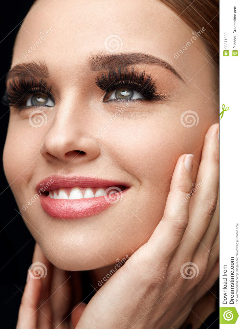 f36117bf93a Closeup Of Glamorous Girl With Hands Touching Soft Smooth Skin. Portrait Of Beautiful  Woman With Perfect Facial Makeup And Long Black Fake Eyelashes.