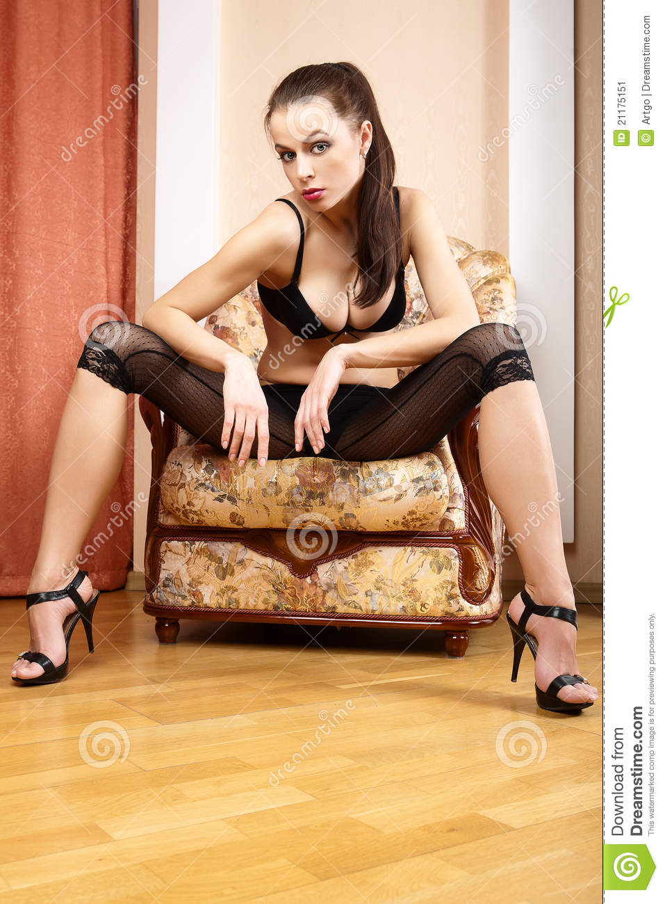 girl is sitting in a chair.
