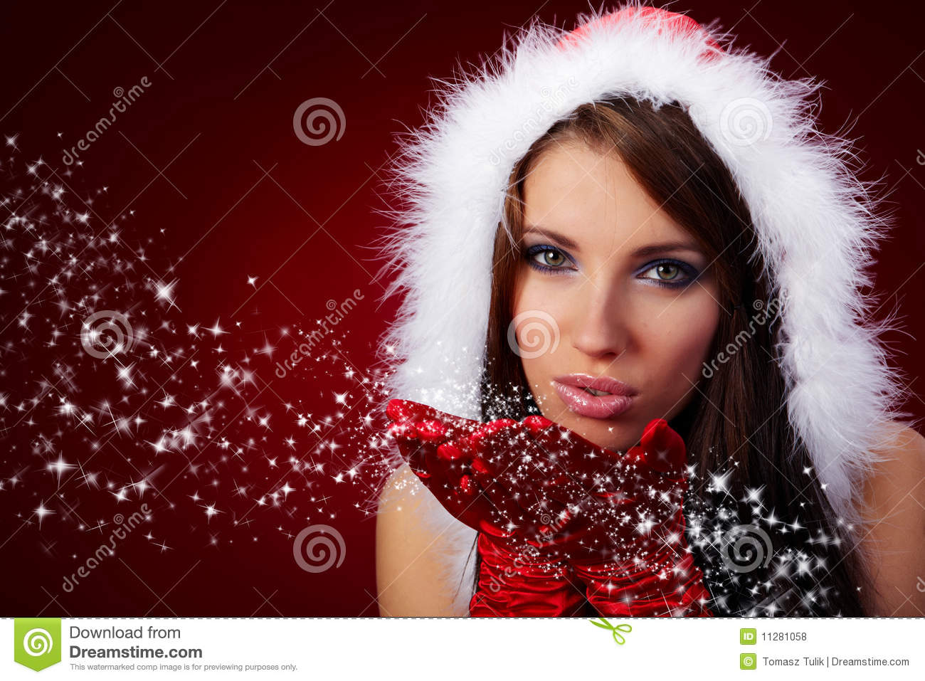 of beautiful sexy girl wearing santa claus clothes on red background
