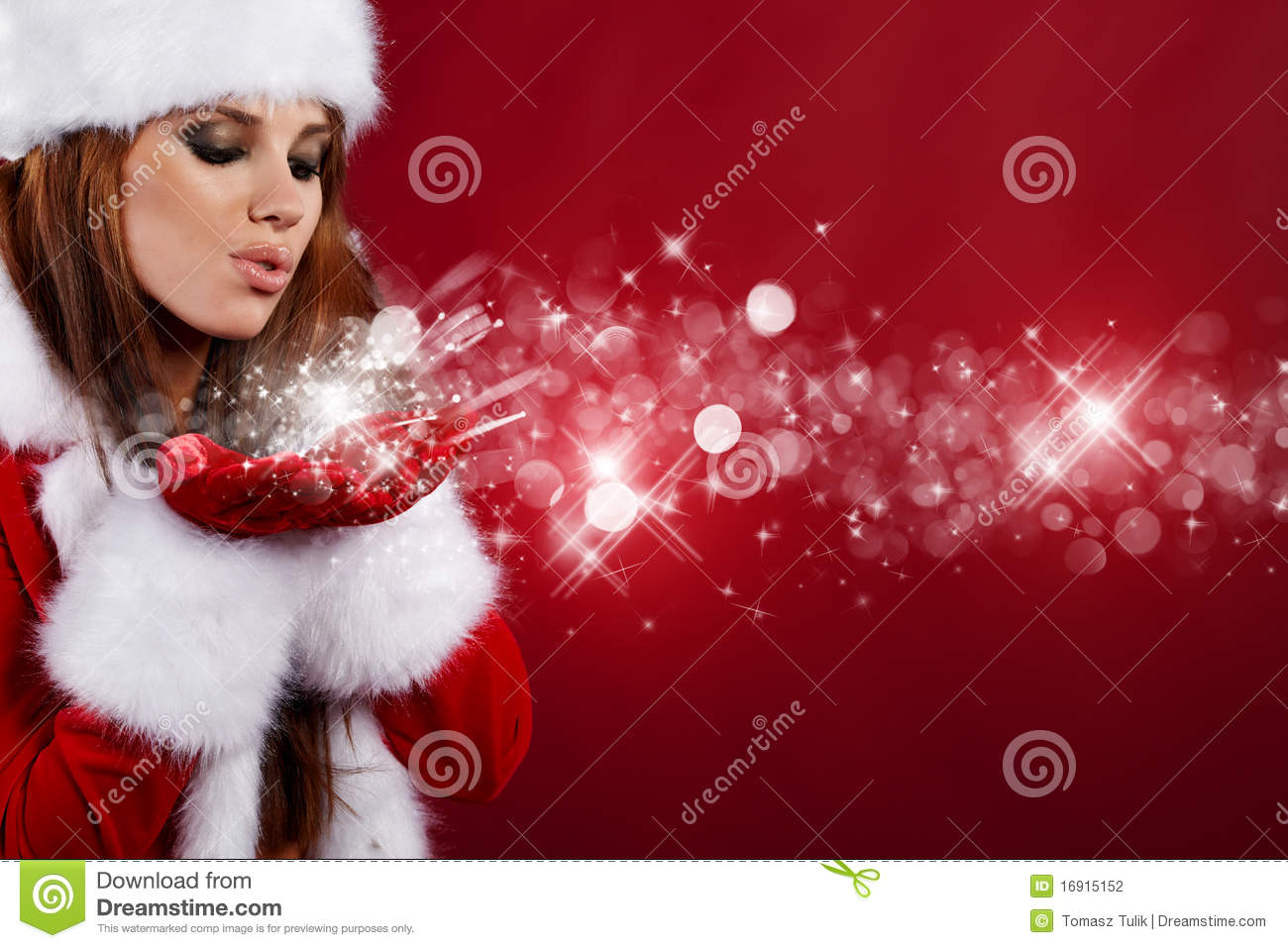 girl wearing santa claus clothes