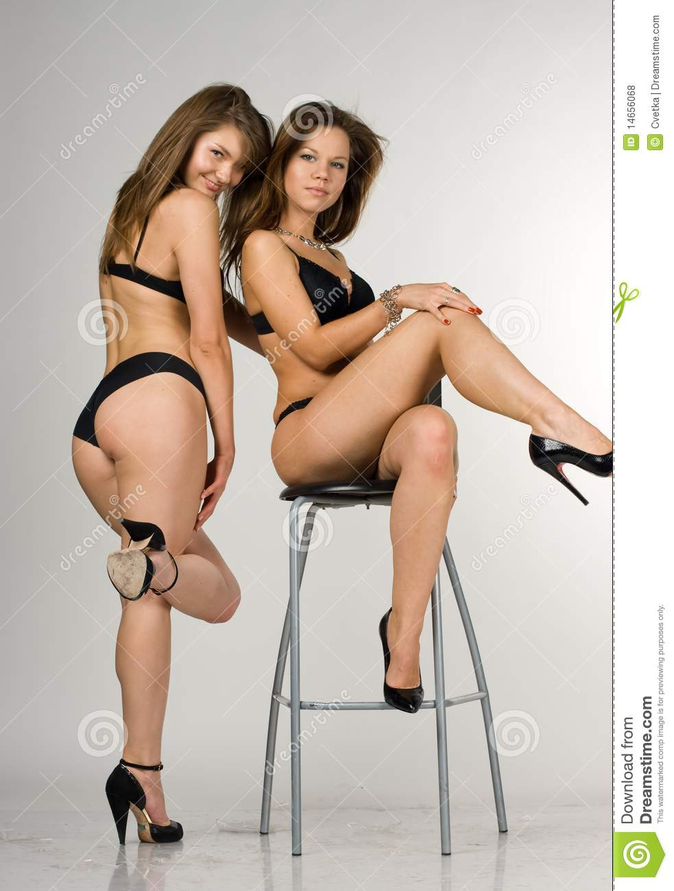 Girls In A Black Swimsuit One Girl Is Sittin Royalty Free