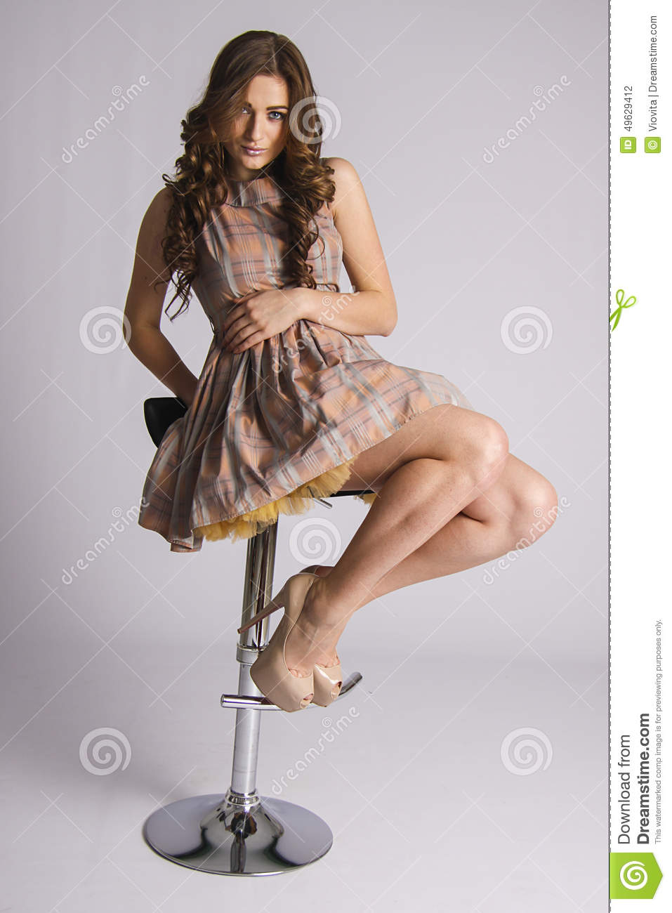 Sexy Glamour Woman Sitting On A Bar Chair Stock Photo