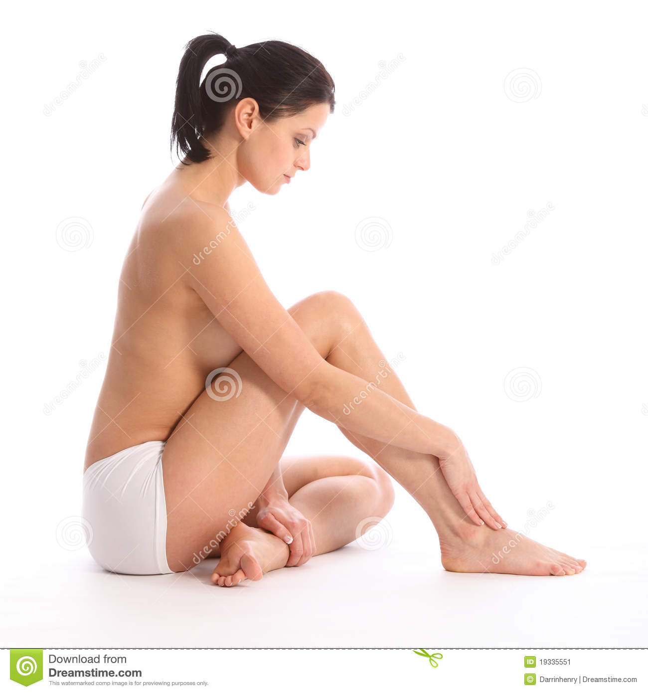 On Floor A Topless Beautiful Healthy Young Woman Wearing White Sports