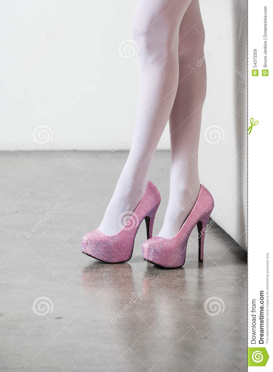 07e9677400db Ladies legs in white stockings and a pair of pink sparkly stiletto high heel  shoes