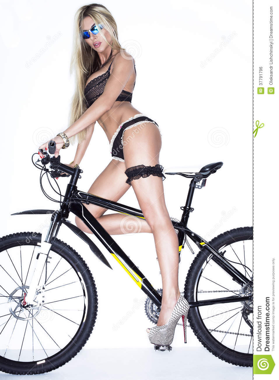 Sexy Lady With Bicycle Isolated On White Background