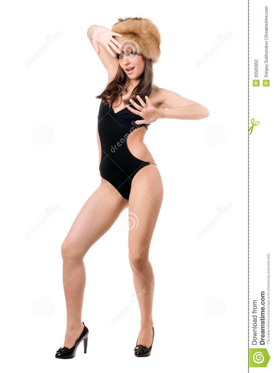 lady posing in swimsuit and fur-cap