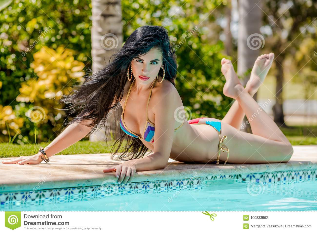 Latina in bikini by a pool advise you